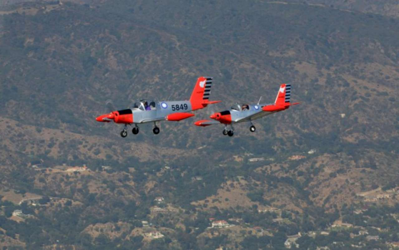 Flying Jeffrey's PL-2 in formation with Leo's PL-1B