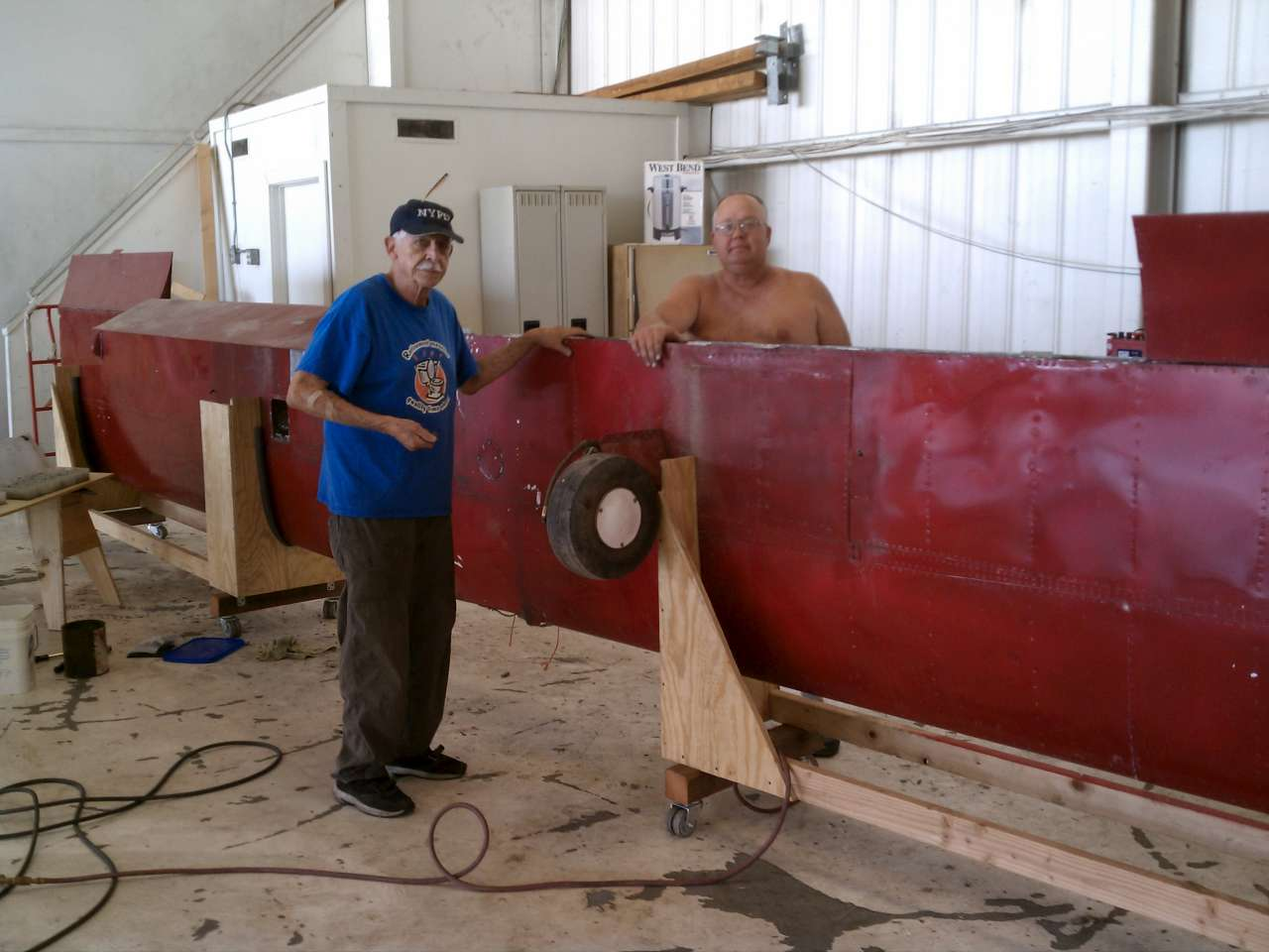 Dick and Chuck were installing the repaired right flap in El Monte